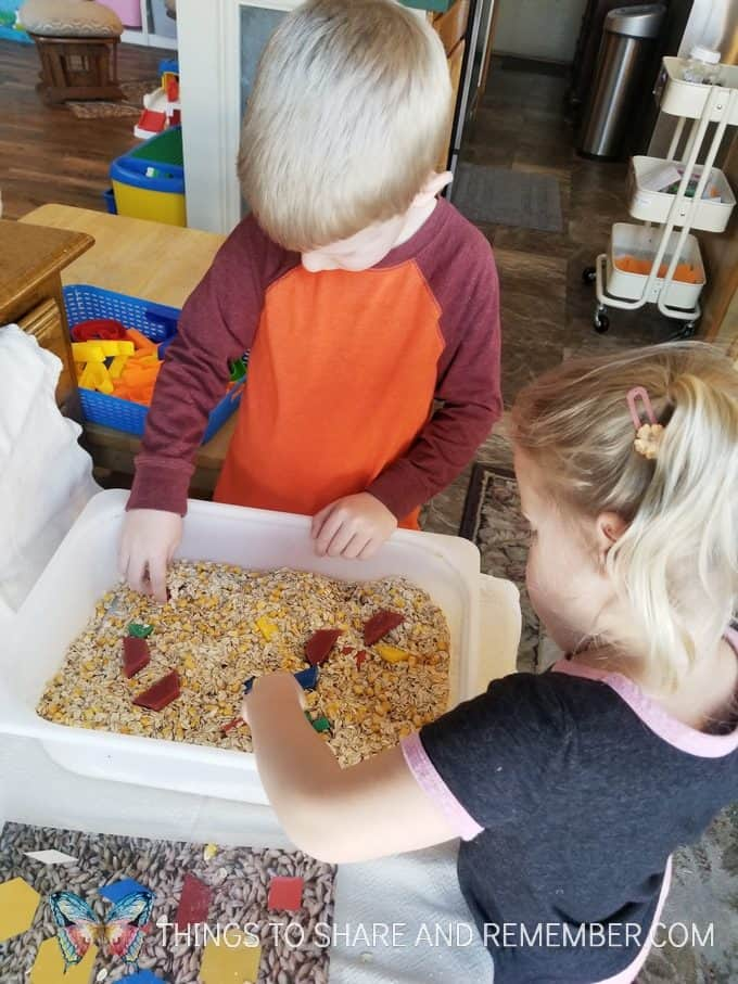 Sensory Shape Discovery Search and Match with grains - Mother Goose Time Health and Fitness theme for February 2019 - Preschool curriculum Food Groups - Grains activities #MGTblogger #MGTHealthandFitness #ece #preschool #nutritiontheme