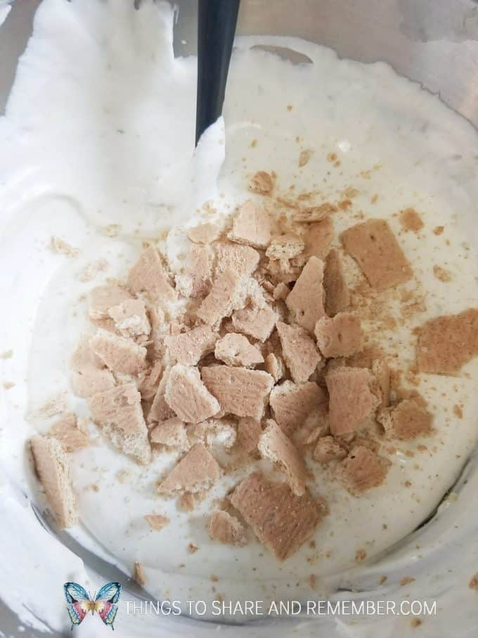 mixing in graham crackers in key lime pie ice cream