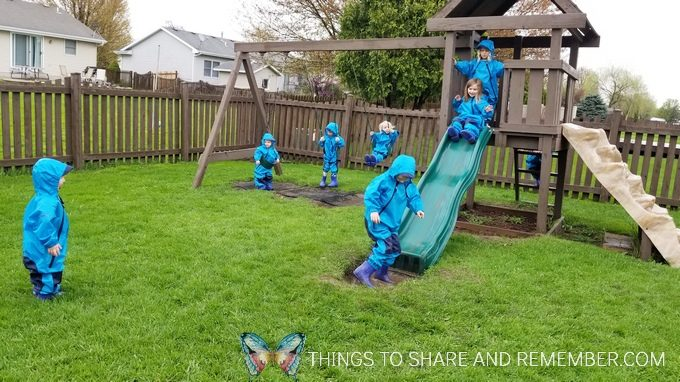 playing outside in the rain with rain gear in preschool