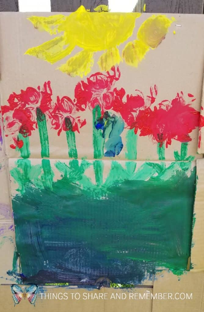 flowers and sun painting on cardboard