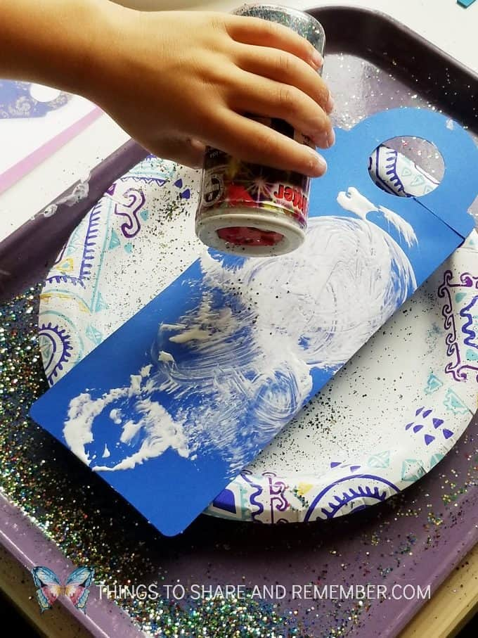 sprinkling glitter Starry Night Door Hanger Make & Play Activity Art Studio - Mother Goose Time Preschool Curriculum