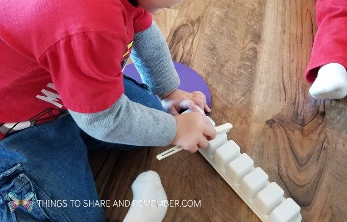 Preschool Dental Health Activities Experience Preschool Brushing Dry Erase Letters off ice cube trays with toothbrushes