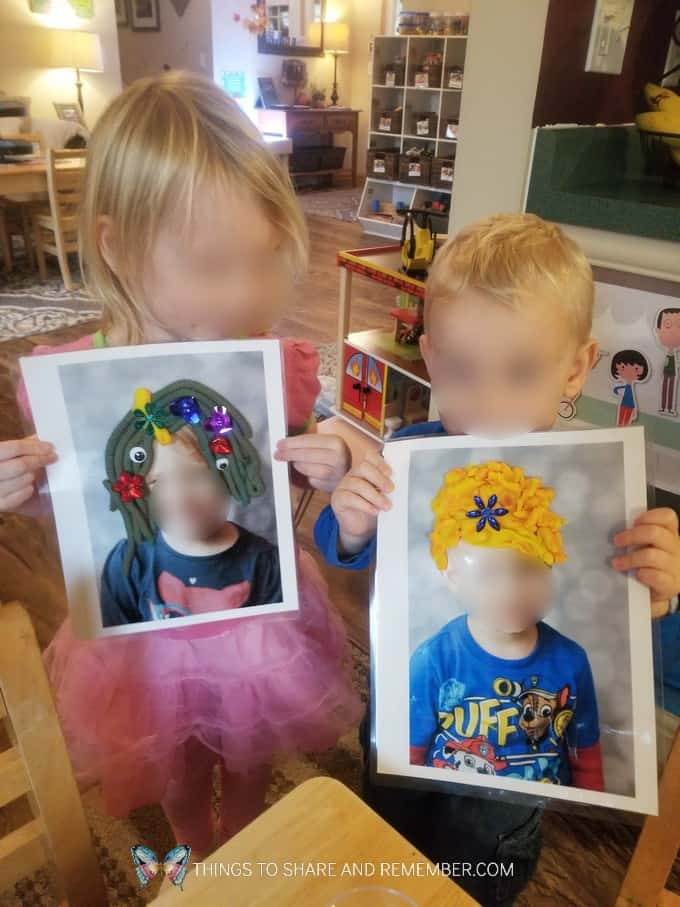 Children holding their photo play dough mats Community Helpers Hairdressers