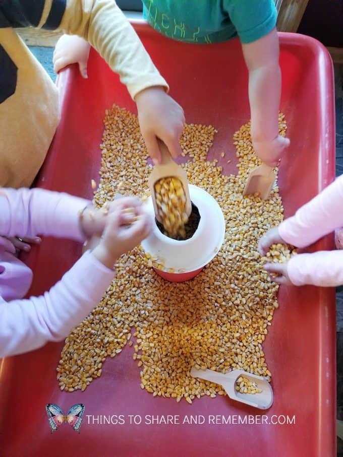 Fill the Silo Farm Sensory Bin Silo made from an oatmeal container | Experience Preschool Curriculum | Down on the Farm preschool theme