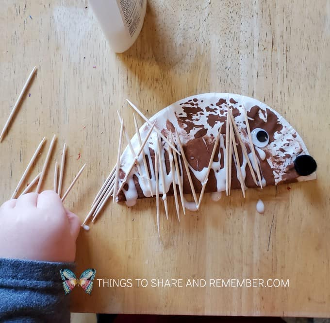 Paper Plate Hedgehog - gluing on toothpicks