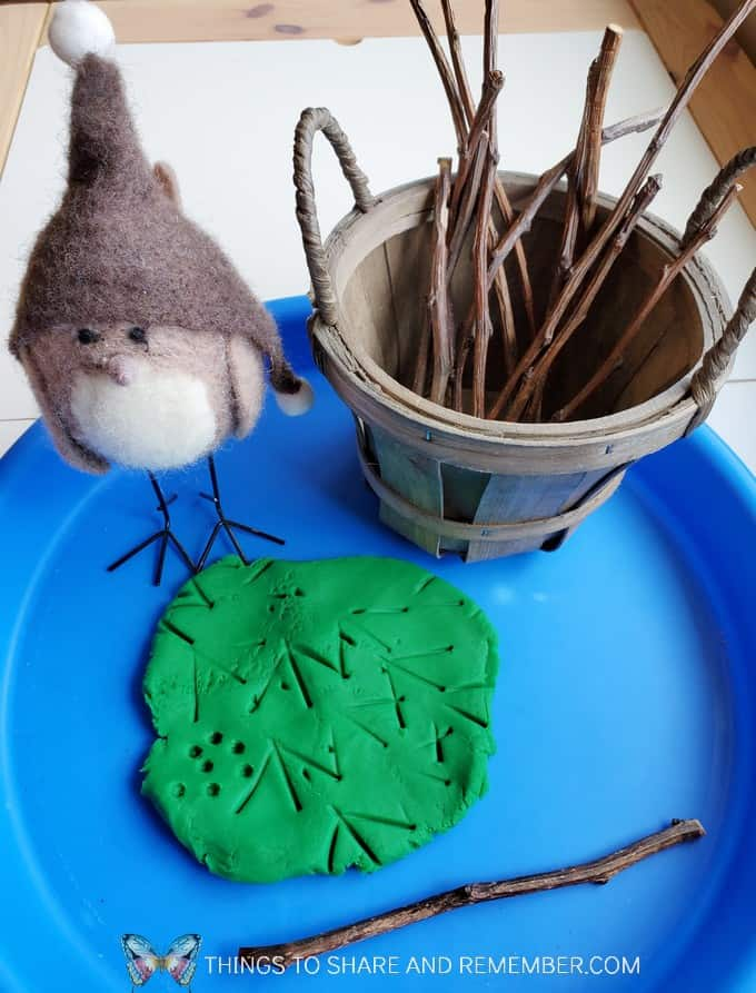 Tray with bird, basket of sticks and play dough Birds & Eggs theme
