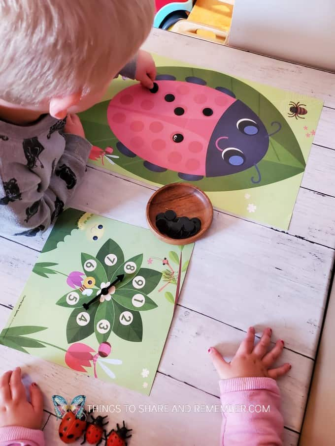 children playing ladybug counting game - painting ladybug spots activities