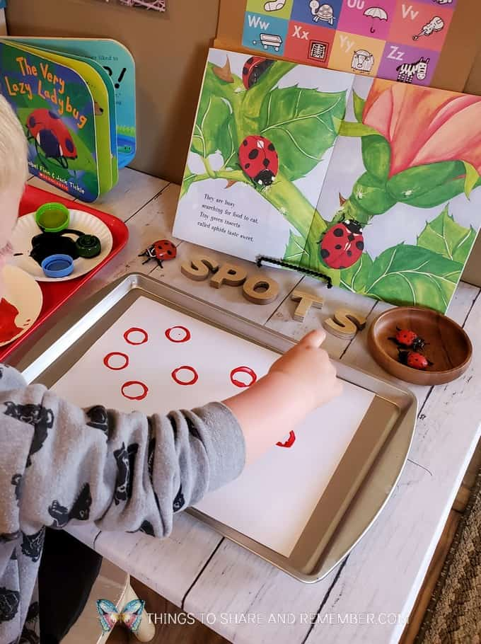 painting ladybug spots and circles with bottle caps