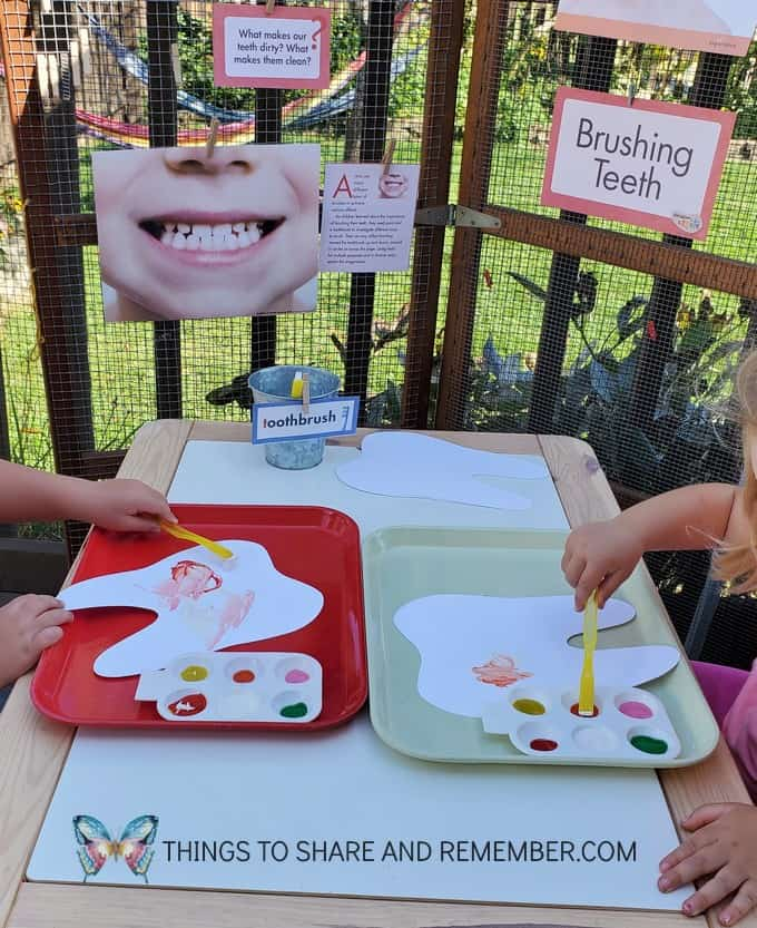 brushing teeth preschool art activity - painting with toothbrushes