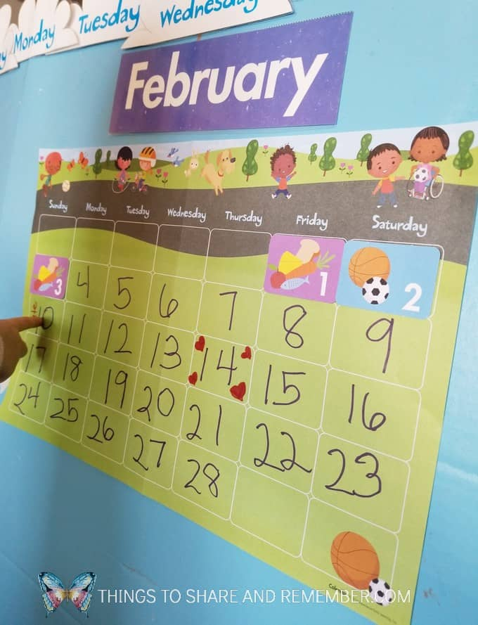 marking the calendar with stickers for holidays and birthdays