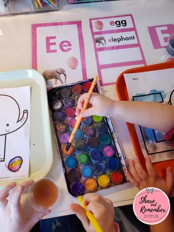 painting letter E Experience Curriculum page
