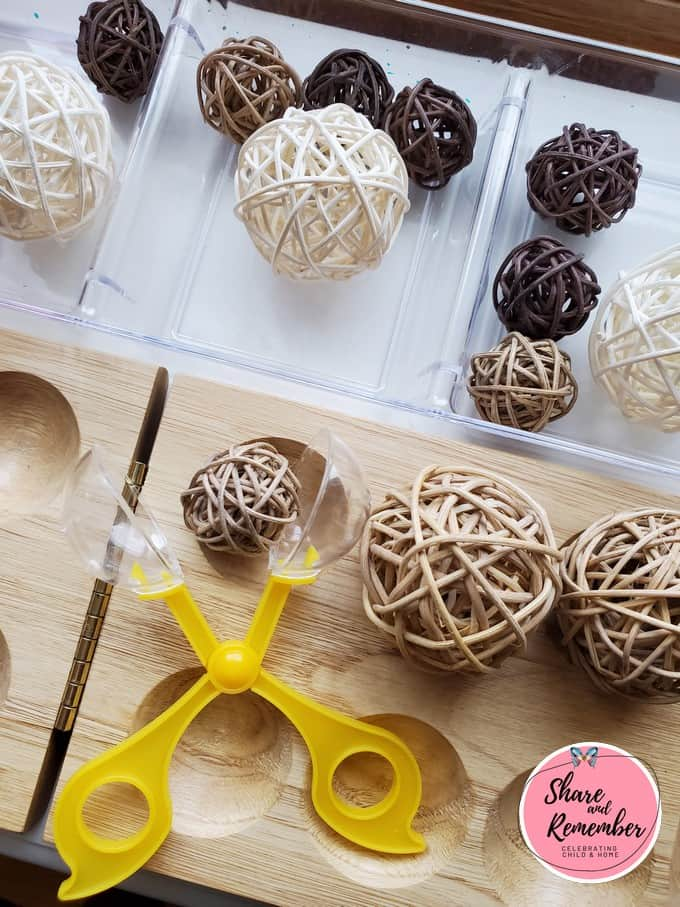 Rattan ball fine motor transfer game that coordinates with Dinosaur Eggs Preschool Activities.