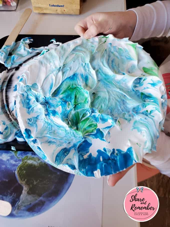 Shaving cream swirl art on a paper plate.