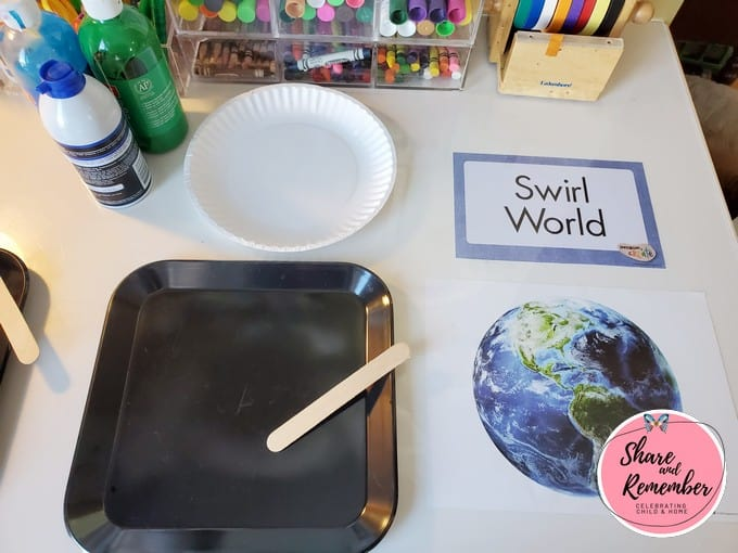 Swirl World process art invitation to create art project set up on table.